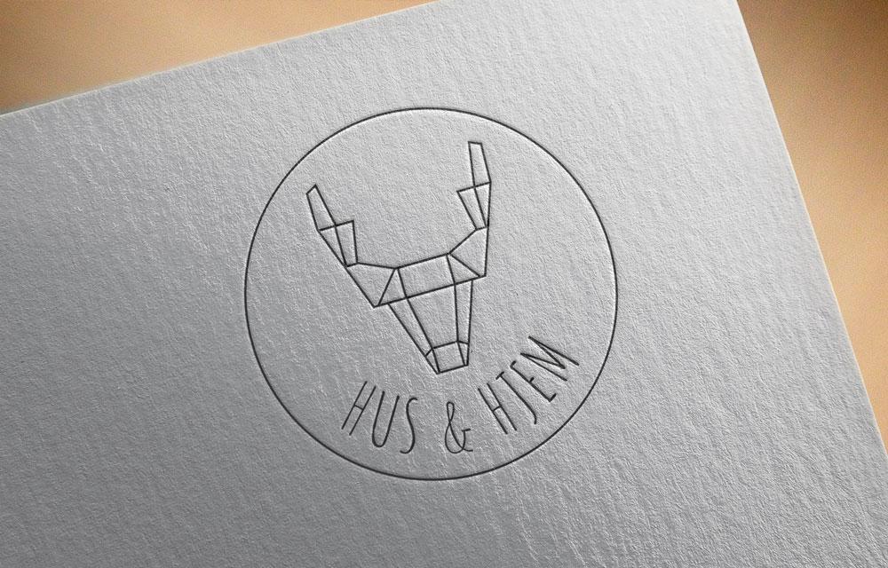 Hus and Hjem logo